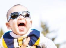 Il bambino piacevole con il blu googla Fotografia Stock