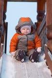 Il bambino prepara fare scorrere giù le trasparenze per i bambini Fotografie Stock