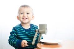 Il bambino produce lo zucchero in polvere Fotografie Stock