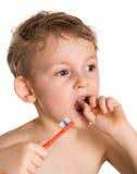 Il bambino pulisce i denti Fotografie Stock Libere da Diritti