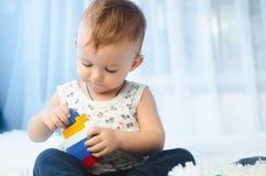 Il bambino raccoglie il progettista Fotografie Stock