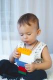 Il bambino raccoglie il progettista Fotografia Stock