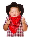 Il bambino si è vestito in su come gioco del cowboy Fotografie Stock Libere da Diritti