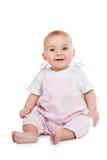 Il bambino sta sedendosi sul pavimento Fotografia Stock Libera da Diritti