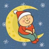 Il bambino sta sedendosi sulla luna in cappuccio di Natale Fotografie Stock Libere da Diritti