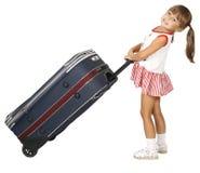 Il bambino tira i bagagli Immagine Stock