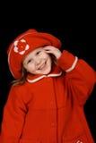 Il bambino in un cappotto rosso fotografia stock