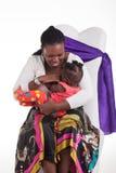 Il bambino vuole essere allattato al senoe Immagini Stock Libere da Diritti