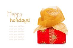 Il bello contenitore di regalo in carta dell'oro con seta è aumentato Fotografia Stock
