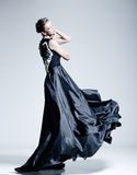 Il bello modello della donna si è vestito in un vestito elegante Fotografia Stock Libera da Diritti