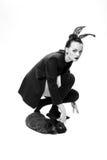 Il bello modello della ragazza in un'immagine di un coniglio Immagine Stock Libera da Diritti