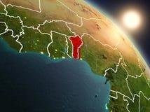 Il Benin da spazio durante l'alba Fotografie Stock