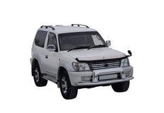 Il bianco di Prado dell'incrociatore della terra di Toyota dell'automobile su un fondo bianco Fotografia Stock