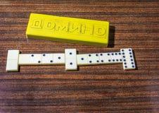 Il bianco disossa il gioco di domino Immagine Stock