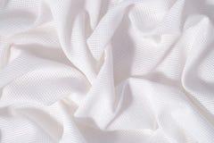 Il bianco ha sgualcito la tela del cotone per cucito come fondo Fotografia Stock