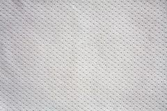 Il bianco mette in mostra il jersey del tessuto dell'abbigliamento Fotografia Stock