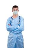 Il blu d'uso del chirurgo sfrega con le armi attraversato Fotografie Stock