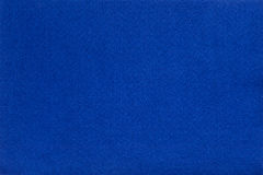 Il blu ha ritenuto il panno del tessuto, fondo di struttura del primo piano Immagine Stock