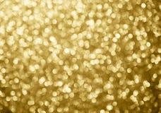 il bokeh astratto del fondo dell'oro circonda per il fondo di Natale Fotografia Stock Libera da Diritti