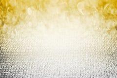 Il bokeh brillante dell'estratto di scintillio del diamante d'argento dell'oro, spazi graziosi di bellezza facile di uso come con Fotografie Stock Libere da Diritti