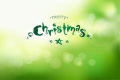 Il bokeh del nuovo anno e di Natale si inverdisce il fondo con l'iscrizione dello scarabocchio Fotografia Stock