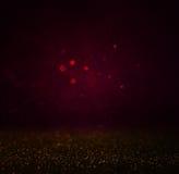 Il bokhe scuro astratto accende l'oro nero e sottile del fondo, di porpora, Priorità bassa Defocused Fotografia Stock