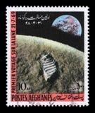 Il bollo stampato in Afghanistan mostra il primo allunaggio Fotografia Stock Libera da Diritti