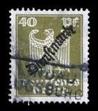 Il bollo stampato in Germania mostra Eagle, stemma della Germania Immagine Stock Libera da Diritti