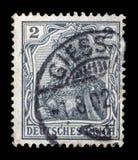 Il bollo stampato in Germania mostra l'allegoria di Germania, personificazione della Germania Immagini Stock