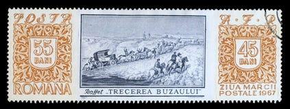 Il bollo stampato in Romania mostra l'incrocio del fiume di Buzau dalla D - A - M. Raffet Fotografia Stock