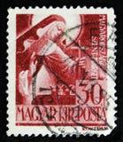 Il bollo ungherese mostra St Margaret dell'Ungheria, circa 1944 Fotografia Stock