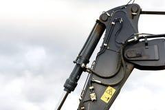 Il braccio a macchina idraulico convoglia l'escavatore Immagini Stock Libere da Diritti