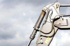 Il braccio a macchina idraulico convoglia l'escavatore Fotografie Stock