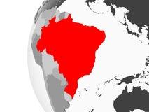 Il Brasile sul globo grigio royalty illustrazione gratis