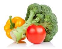 Il broccolo, il pomodoro ed il peperone dolce giallo hanno isolato Fotografie Stock
