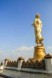 Il Buddha di camminata Fotografie Stock
