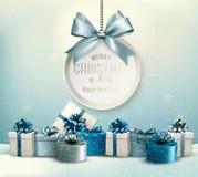 Il Buon Natale carda con un nastro ed i contenitori di regalo Fotografia Stock