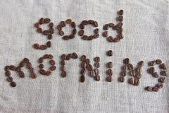 Il buongiorno dell'iscrizione dei chicchi di caffè Immagini Stock