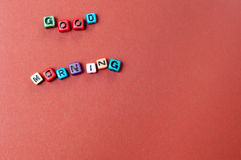 Il buongiorno di parole ha spiegato nelle perle del cubo Fotografia Stock