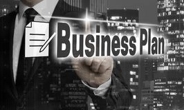 Il business plan è indicato dal concetto dell'uomo d'affari fotografia stock