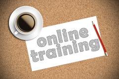 Il caffè e la matita schizzano l'addestramento online su carta Immagini Stock Libere da Diritti