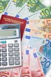 Il calcolatore, il passaporto e l'euro Immagini Stock Libere da Diritti