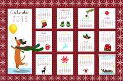 Il calendario creativo mensile 2018 con il cane su tessuto rosso ha tricottato le sedere Fotografia Stock