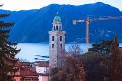Il campanile e lago di Lugano Fotografie Stock Libere da Diritti