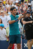 Il campione Roger Federer del Grande Slam di diciassette volte della Svizzera celebra la vittoria dopo il primo US Open 2015 del  Fotografia Stock