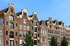 Il canale alloggia Amsterdam Immagine Stock
