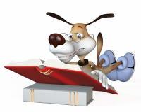 Il cane legge il libro. Immagine Stock