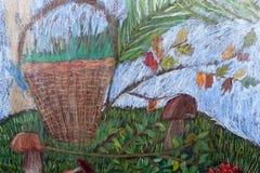 Il canestro con i funghi sul prato di autunno Fotografie Stock