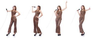 Il cantante della donna con il microfono su bianco Fotografia Stock