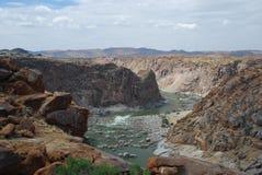 Il canyon arancio del fiume a Augrabies cade parco nazionale. Capo Nord, Sudafrica Fotografia Stock